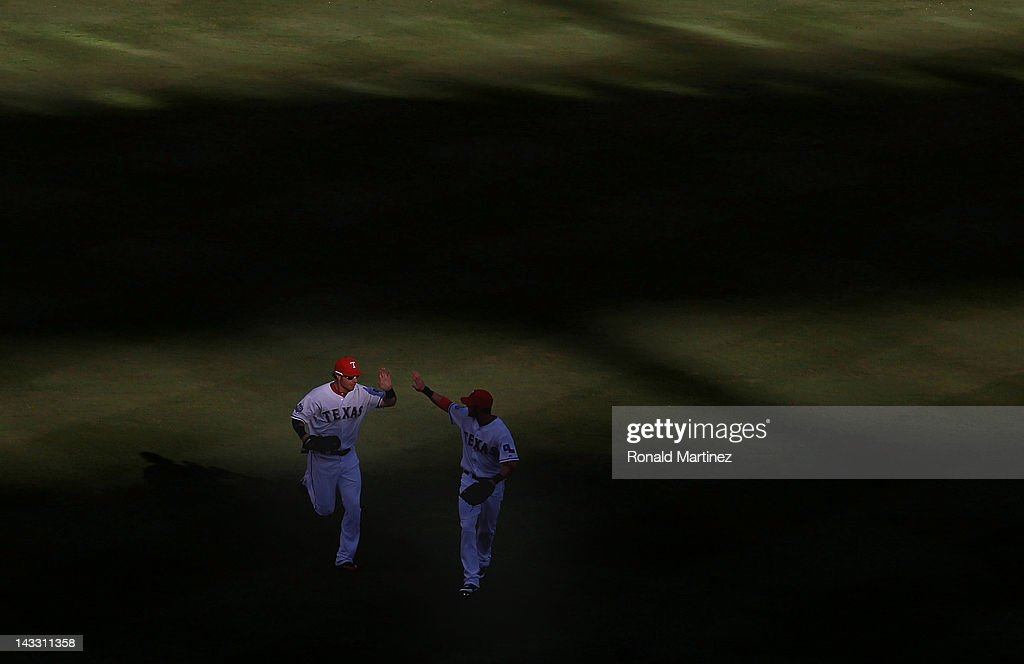 Josh Hamilton #32 of the Texas Rangers and <a gi-track='captionPersonalityLinkClicked' href=/galleries/search?phrase=Elvis+Andrus&family=editorial&specificpeople=4845974 ng-click='$event.stopPropagation()'>Elvis Andrus</a> celebrate the final out of the second inning against the New York Yankees at Rangers Ballpark in Arlington on April 23, 2012 in Arlington, Texas.