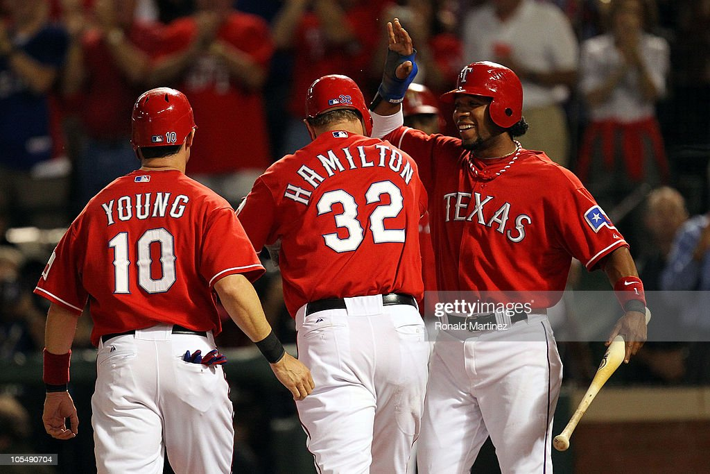 <a gi-track='captionPersonalityLinkClicked' href=/galleries/search?phrase=Josh+Hamilton&family=editorial&specificpeople=234355 ng-click='$event.stopPropagation()'>Josh Hamilton</a> #32 of the Texas Rangers celebrates with <a gi-track='captionPersonalityLinkClicked' href=/galleries/search?phrase=Elvis+Andrus&family=editorial&specificpeople=4845974 ng-click='$event.stopPropagation()'>Elvis Andrus</a> #1 and <a gi-track='captionPersonalityLinkClicked' href=/galleries/search?phrase=Michael+Young&family=editorial&specificpeople=203149 ng-click='$event.stopPropagation()'>Michael Young</a> #10 after Hamilton's three run home run in the first inning against the New York Yankees in Game One of the ALCS during the 2010 MLB Playoffs at Rangers Ballpark in Arlington on October 15, 2010 in Arlington, Texas.