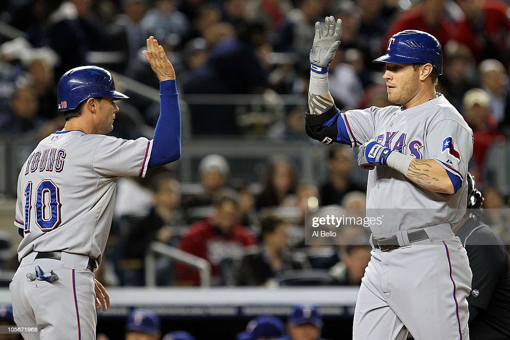 Josh Hamilton of the Texas Rangers celebrates with Michael Young after hitting a two run homerun in the first inning against the New York Yankeesin...