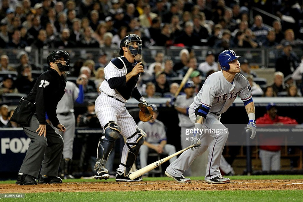 <a gi-track='captionPersonalityLinkClicked' href=/galleries/search?phrase=Josh+Hamilton&family=editorial&specificpeople=234355 ng-click='$event.stopPropagation()'>Josh Hamilton</a> #32 of the Texas Rangers hits a 2-run home run in the top of the first inning against the New York Yankees in Game Three of the ALCS during the 2010 MLB Playoffs at Yankee Stadium on October 18, 2010 in New York, New York.