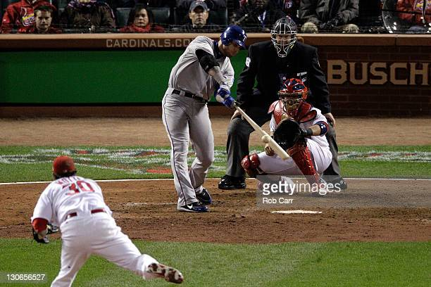 Josh Hamilton of the Texas Rangers hits a tworun home run in the 10th inning off of Jason Motte of the St Louis Cardinals during Game Six of the MLB...