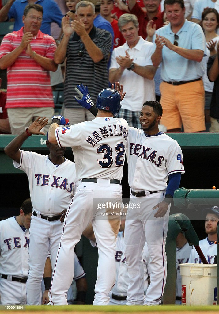 Josh Hamilton #32 of the Texas Rangers is congratulated by teammate <a gi-track='captionPersonalityLinkClicked' href=/galleries/search?phrase=Elvis+Andrus&family=editorial&specificpeople=4845974 ng-click='$event.stopPropagation()'>Elvis Andrus</a> #1 after hitting a solo home run against the Tampa Bay Rays on August 29, 2012 at the Rangers Ballpark in Arlington in Arlington, Texas.