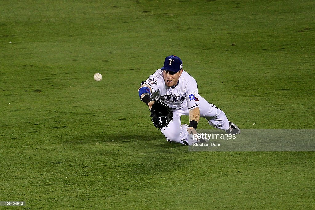 <a gi-track='captionPersonalityLinkClicked' href=/galleries/search?phrase=Josh+Hamilton&family=editorial&specificpeople=234355 ng-click='$event.stopPropagation()'>Josh Hamilton</a> #32 of the Texas Rangers makes a diving catch in the second inning against the San Francisco Giants in Game Four of the 2010 MLB World Series at Rangers Ballpark in Arlington on October 31, 2010 in Arlington, Texas.