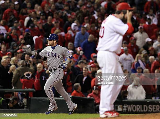 Josh Hamilton of the Texas Rangers rounds the bases after hitting a tworun home run in the 10th inning off of Jason Motte of the St Louis Cardinals...