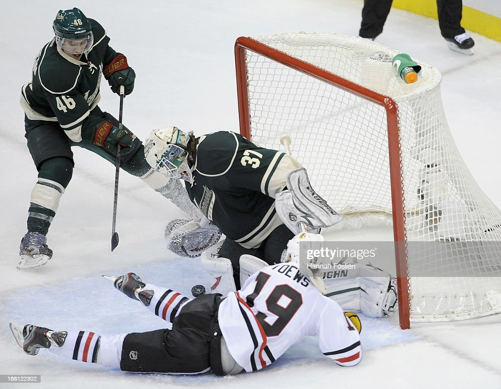 <a gi-track='captionPersonalityLinkClicked' href=/galleries/search?phrase=Josh+Harding&family=editorial&specificpeople=700587 ng-click='$event.stopPropagation()'>Josh Harding</a> #37 of the Minnesota Wild deflects the shot by <a gi-track='captionPersonalityLinkClicked' href=/galleries/search?phrase=Jonathan+Toews&family=editorial&specificpeople=537799 ng-click='$event.stopPropagation()'>Jonathan Toews</a> #19 of the Chicago Blackhawks as <a gi-track='captionPersonalityLinkClicked' href=/galleries/search?phrase=Jared+Spurgeon&family=editorial&specificpeople=4594192 ng-click='$event.stopPropagation()'>Jared Spurgeon</a> #46 of the Minnesota Wild looks on during the third period of Game Three of the Western Conference Quarterfinals during the 2013 NHL Stanley Cup Playoffs at Xcel Energy Center on May 5, 2013 in St Paul, Minnesota. The Wild defeated the Blackhawks 3-2 in overtime.