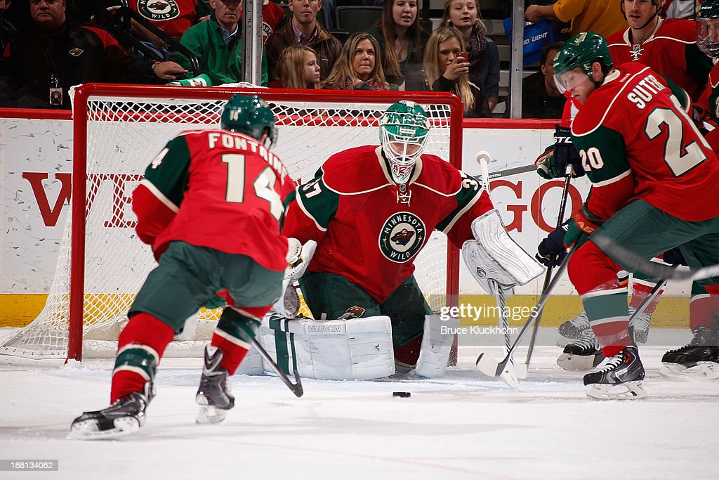 <a gi-track='captionPersonalityLinkClicked' href=/galleries/search?phrase=Josh+Harding&family=editorial&specificpeople=700587 ng-click='$event.stopPropagation()'>Josh Harding</a> #37 of the Minnesota Wild makes a save as teammates <a gi-track='captionPersonalityLinkClicked' href=/galleries/search?phrase=Justin+Fontaine&family=editorial&specificpeople=8312194 ng-click='$event.stopPropagation()'>Justin Fontaine</a> #14 and <a gi-track='captionPersonalityLinkClicked' href=/galleries/search?phrase=Ryan+Suter&family=editorial&specificpeople=583306 ng-click='$event.stopPropagation()'>Ryan Suter</a> #20 defend against the Florida Panthers during the game on November 15, 2013 at the Xcel Energy Center in St. Paul, Minnesota.
