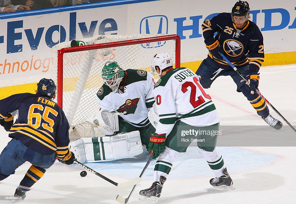 <a gi-track='captionPersonalityLinkClicked' href=/galleries/search?phrase=Josh+Harding&family=editorial&specificpeople=700587 ng-click='$event.stopPropagation()'>Josh Harding</a> #37 of the Minnesota Wild makes save on Brian Flynn #65 of the Buffalo Sabres as <a gi-track='captionPersonalityLinkClicked' href=/galleries/search?phrase=Ryan+Suter&family=editorial&specificpeople=583306 ng-click='$event.stopPropagation()'>Ryan Suter</a> #20 of the Wild and <a gi-track='captionPersonalityLinkClicked' href=/galleries/search?phrase=Mikhail+Grigorenko&family=editorial&specificpeople=8771251 ng-click='$event.stopPropagation()'>Mikhail Grigorenko</a> #25 of the Sabres look on at First Niagara Center on October 14, 2013 in Buffalo, New York.