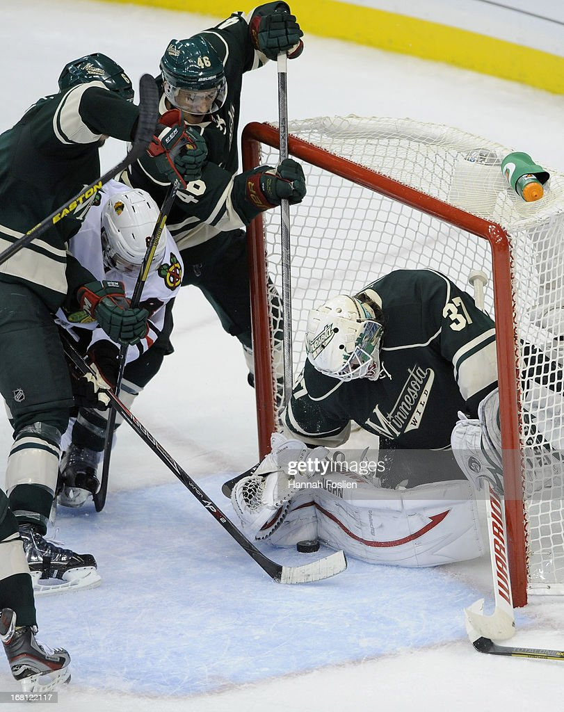 <a gi-track='captionPersonalityLinkClicked' href=/galleries/search?phrase=Josh+Harding&family=editorial&specificpeople=700587 ng-click='$event.stopPropagation()'>Josh Harding</a> #37 of the Minnesota Wild stops the shot by Jonathan Toews #19 of the Chicago Blackhawks during the third period of Game Three of the Western Conference Quarterfinals during the 2013 NHL Stanley Cup Playoffs at Xcel Energy Center on May 5, 2013 in St Paul, Minnesota. The Wild defeated the Blackhawks 3-2 in overtime.
