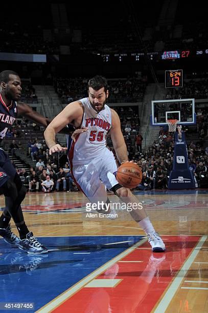 Josh Harrellson of the Detroit Pistons drives to the basket against the Atlanta Hawks on November 22 2013 at The Palace of Auburn Hills in Auburn...
