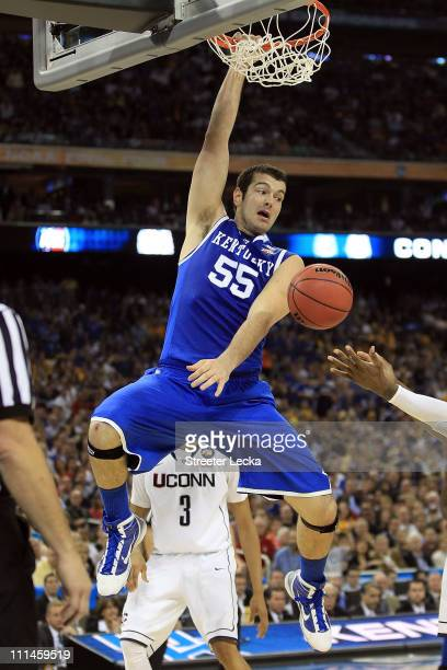 Josh Harrellson of the Kentucky Wildcats dunks the ball against the Connecticut Huskies during the National Semifinal game of the 2011 NCAA Division...