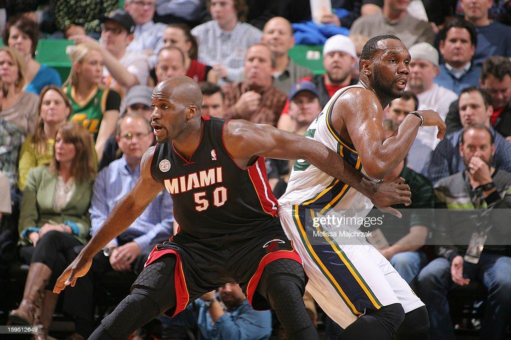 Josh Harrellson #50 of the Miami Heat and Al Jefferson #25 of the Utah Jazz establish position at Energy Solutions Arena on January 14, 2013 in Salt Lake City, Utah.