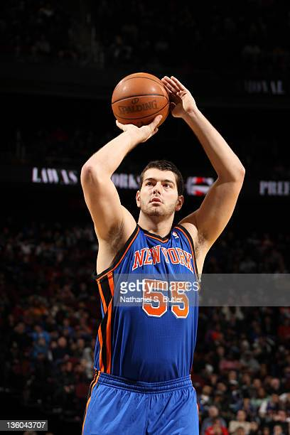 Josh Harrellson of the New York Knicks shoots a foul shot against the New York Knicks during the preseason game on December 17 2011 at the Prudential...