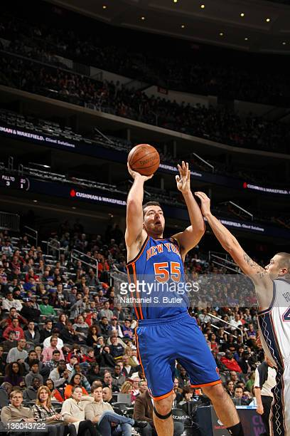 Josh Harrellson of the New York Knicks shoots against the New York Knicks during the preseason game on December 17 2011 at the Prudential Center in...