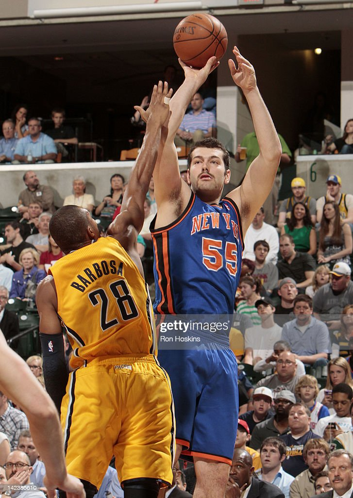 Josh Harrellson #55 of the New York Knicks takes a jump shot over Leandro Barbosa #28 of the Indiana Pacers during the game on April 3, 2012 at Bankers Life Fieldhouse in Indianapolis, Indiana.