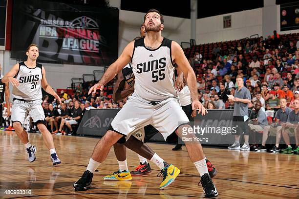 Josh Harrellson of the Phoenix Suns battles for position against the Phoenix Suns during the 2015 NBA Las Vegas Summer League game on July 16 2015 at...