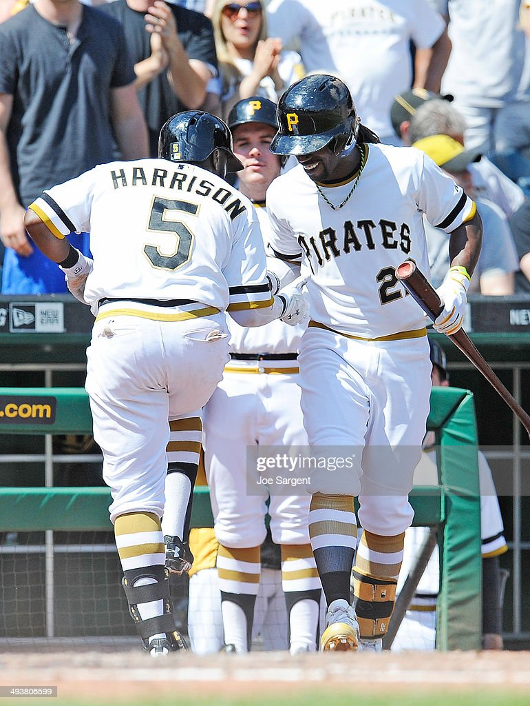 Josh Harrison #5 celebrates his solo home run with Andrew McCutchen #22 of the Pittsburgh Pirates during the sixth inning against the Washington Nationals on May 25, 2014 at PNC Park in Pittsburgh, Pennsylvania.