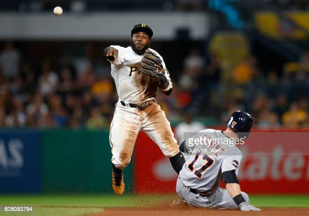 Josh Harrison of the Pittsburgh Pirates attempts turning a double play against the Detroit Tigers during interleague play at PNC Park on August 7...