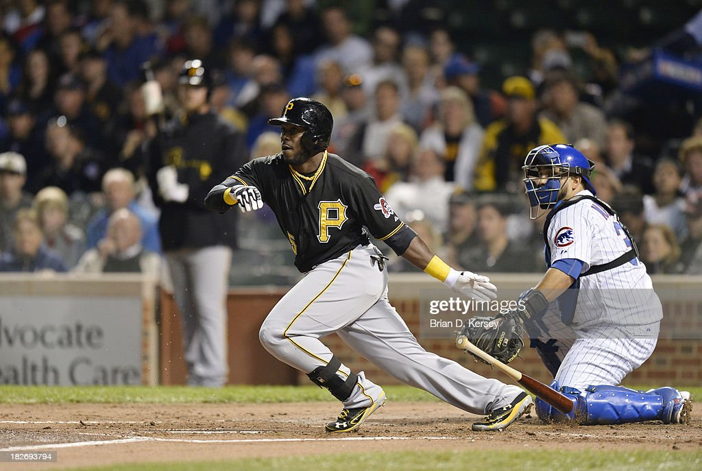 Josh Harrison #5 of the Pittsburgh Pirates bats during the second inning against the Chicago Cubs at Wrigley Field on September 24, 2013 in Chicago, Illinois. The Pirates defeated the Cubs 8-2. (Photo by Brian D. Kersey/Getty Images) ~~~