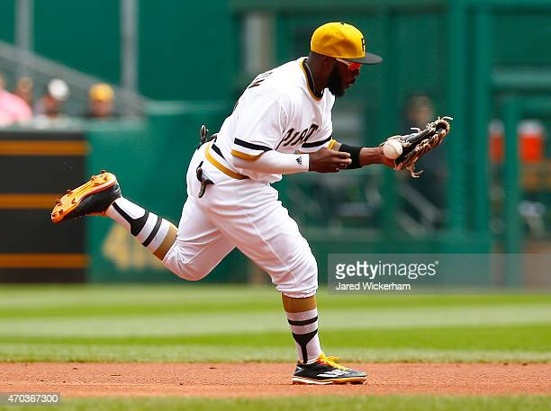 Josh Harrison of the Pittsburgh Pirates bobbles a ground ball in the first inning against the Milwaukee Brewers during the game at PNC Park on April...