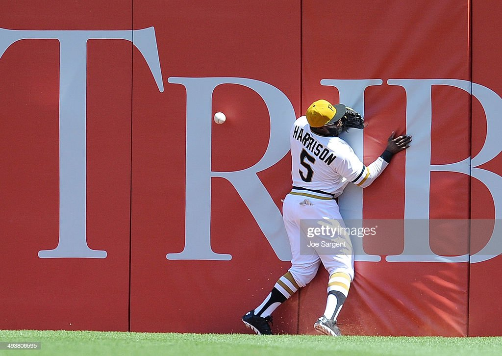Josh Harrison #5 of the Pittsburgh Pirates can't make a catch on a ball hit by Anthony Rendon #6 of the Washington Nationals during the fifth inning on May 25, 2014 at PNC Park in Pittsburgh, Pennsylvania.