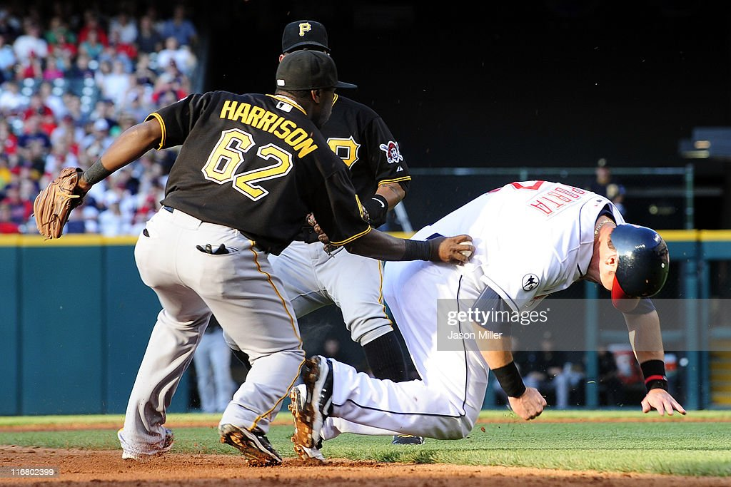 Josh Harrison #62 of the Pittsburgh Pirates catches <a gi-track='captionPersonalityLinkClicked' href=/galleries/search?phrase=Matt+LaPorta&family=editorial&specificpeople=2315200 ng-click='$event.stopPropagation()'>Matt LaPorta</a> #7 of the Cleveland Indians in a run down between second and third during the third inning at Progressive Field on June 17, 2011 in Cleveland, Ohio.