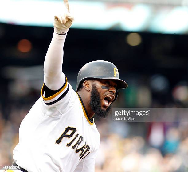 Josh Harrison of the Pittsburgh Pirates celebrates after hitting a walk off single in the eleventh inning during the game against the Milwaukee...