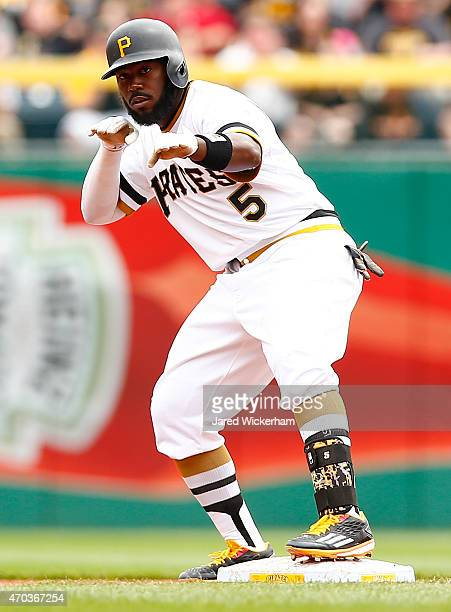 Josh Harrison of the Pittsburgh Pirates celebrates his double in the first inning against the Milwaukee Brewers during the game at PNC Park on April...