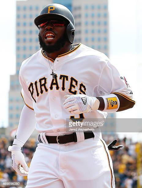 Josh Harrison of the Pittsburgh Pirates celebrates his solo home run in the first inning against the Detroit Tigers during the Opening Day game at...