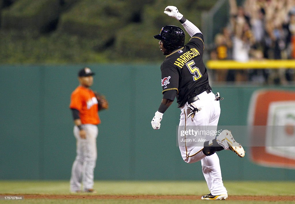 Josh Harrison #5 of the Pittsburgh Pirates celebrates while rounding the bases after hitting a ninth inning walk off home run against the Miami Marlins during the game on August 6, 2013 at PNC Park in Pittsburgh, Pennsylvania. The Pirates defeated the Marlins 4-3.