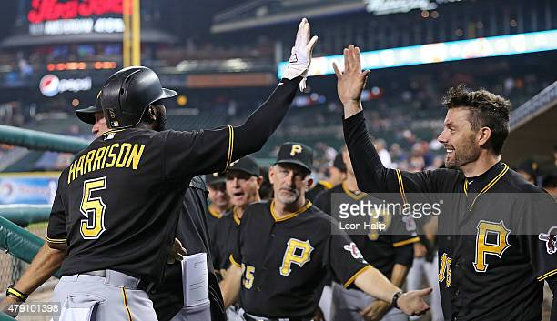 Josh Harrison of the Pittsburgh Pirates celebrates with Chris Stewart after scoring on the double by Neil Walker in the 14th inning of the...