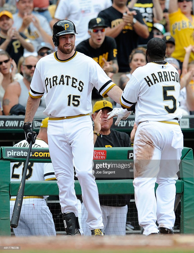 <a gi-track='captionPersonalityLinkClicked' href=/galleries/search?phrase=Josh+Harrison+-+Baseball+Player&family=editorial&specificpeople=6241736 ng-click='$event.stopPropagation()'>Josh Harrison</a> #5 of the Pittsburgh Pirates celebrates with <a gi-track='captionPersonalityLinkClicked' href=/galleries/search?phrase=Ike+Davis&family=editorial&specificpeople=2349664 ng-click='$event.stopPropagation()'>Ike Davis</a> #15 after scoring during the third inning against the Philadelphia Phillies on July 6, 2014 at PNC Park in Pittsburgh, Pennsylvania.