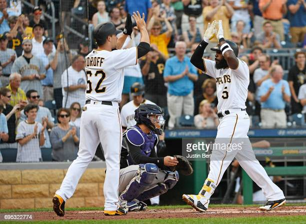 Josh Harrison of the Pittsburgh Pirates celebrates with Max Moroff after hitting a two run home run in the first inning during the game against the...