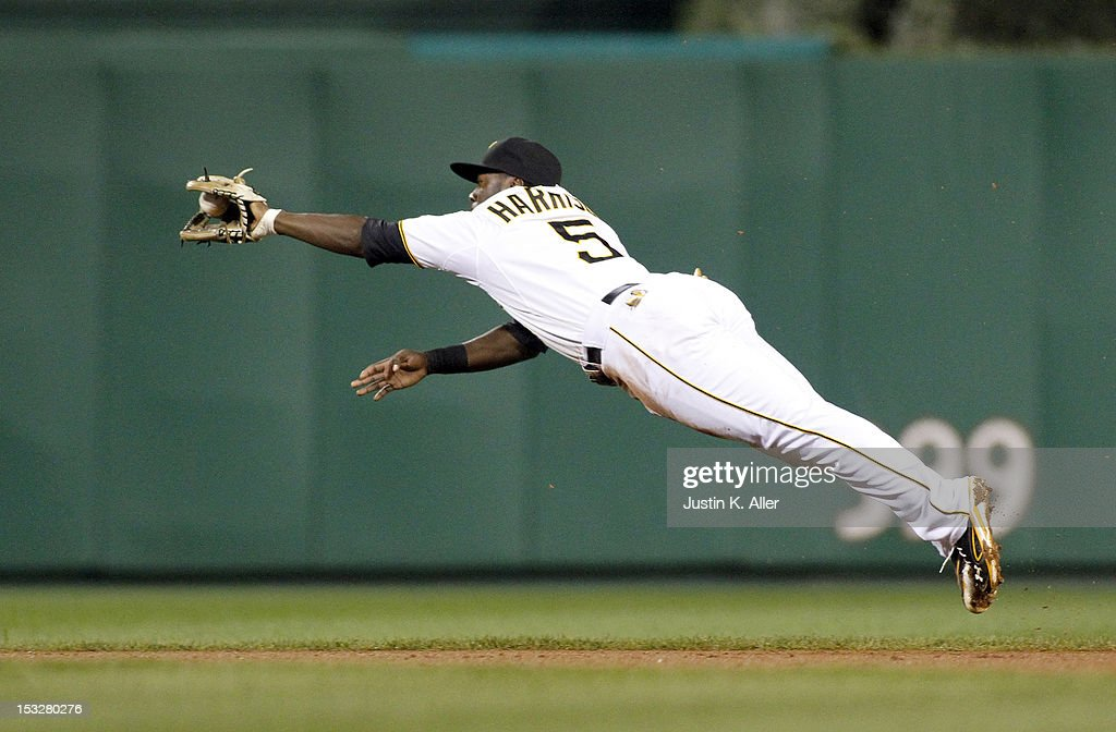 Josh Harrison #5 of the Pittsburgh Pirates fields a ground ball in the fifth inning against the Atlanta Braves during the game on October 2, 2012 at PNC Park in Pittsburgh, Pennsylvania.