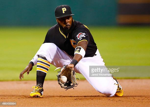 Josh Harrison of the Pittsburgh Pirates fields a ground ball in the first inning against the St Louis Cardinals during the game at PNC Park on...