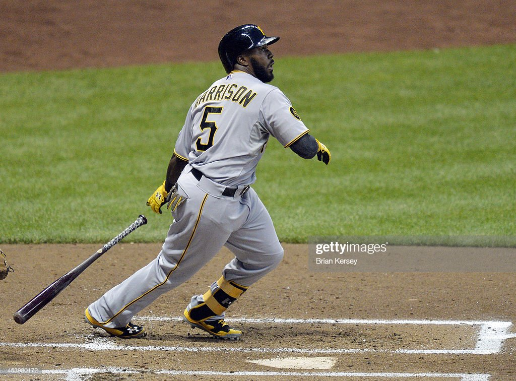 Josh Harrison #5 of the Pittsburgh Pirates follows through on an RBI double scoring teammates Gaby Sanchez and Starling Marte during the second inning against the Milwaukee Brewers at Miller Park on August 22, 2014 in Milwaukee, Wisconsin.
