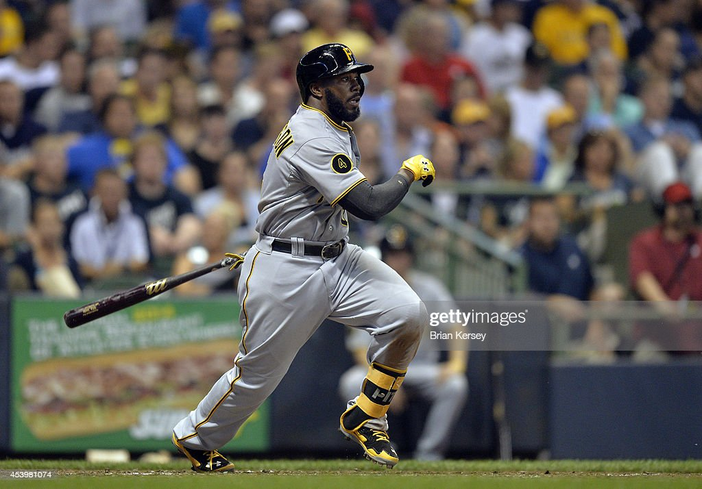 Josh Harrison #5 of the Pittsburgh Pirates follows through on an RBI single scoring teammate Starling Marte during the fourth inning against the Milwaukee Brewers at Miller Park on August 22, 2014 in Milwaukee, Wisconsin.