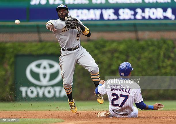 Josh Harrison of the Pittsburgh Pirates forces Addison Russell of the Chicago Cubs at second base in the 2nd inning at Wrigley Field on May 15 2016...