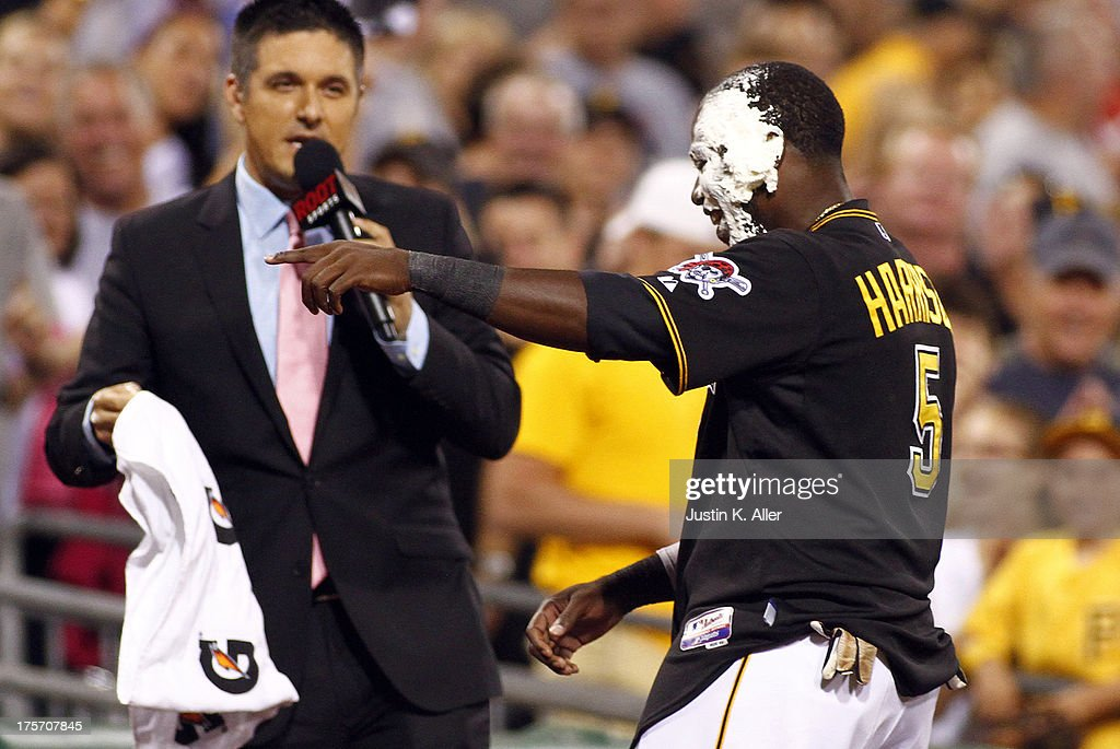 Josh Harrison #5 of the Pittsburgh Pirates gets a pie in the face after hitting a walk off home run in the ninth inning against the Miami Marlins on August 6, 2013 at PNC Park in Pittsburgh, Pennsylvania. The Pirates defeated the Marlins 4-3.