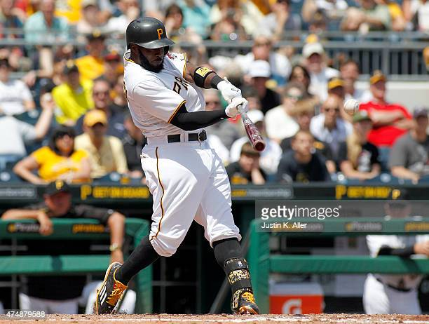 Josh Harrison of the Pittsburgh Pirates hits a RBI single in the seventh inning during the game against the Miami Marlins at PNC Park on May 27 2015...