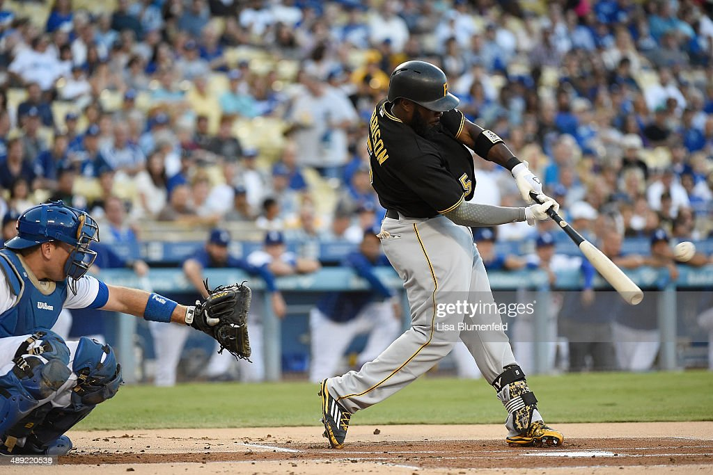 Josh Harrison #5 of the Pittsburgh Pirates hits a single in the first inning against the Los Angeles Dodgers at Dodger Stadium on September 19, 2015 in Los Angeles, California.