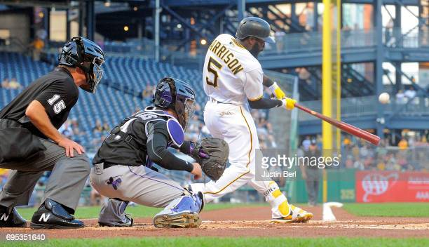 Josh Harrison of the Pittsburgh Pirates hits a two run home run in the first inning during the game against the Colorado Rockies at PNC Park on June...
