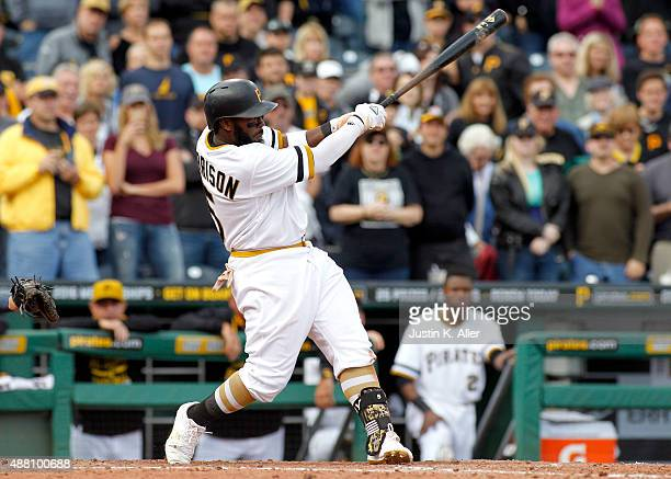 Josh Harrison of the Pittsburgh Pirates hits a walk off single in the eleventh inning during the game against the Milwaukee Brewers at PNC Park on...