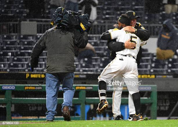 Josh Harrison of the Pittsburgh Pirates hugs Clint Hurdle of the Pittsburgh Pirates after hitting a walk off single giving the Pittsburgh Pirates a...