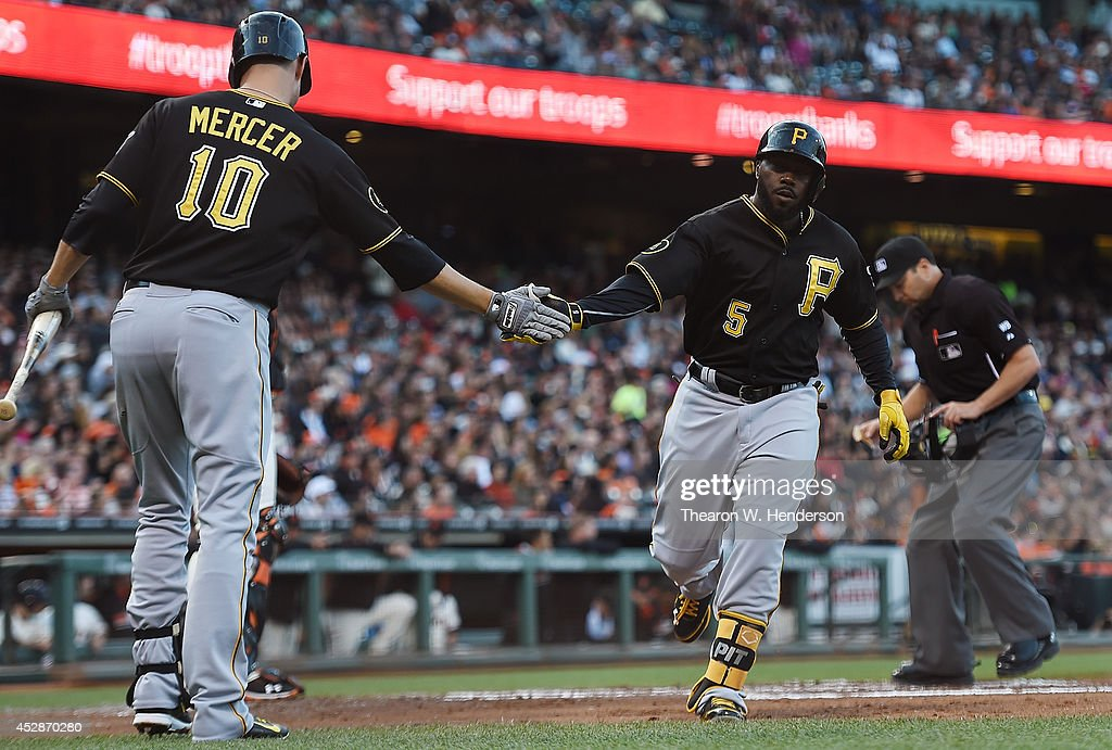 Josh Harrison #5 of the Pittsburgh Pirates is congratulated by <a gi-track='captionPersonalityLinkClicked' href=/galleries/search?phrase=Jordy+Mercer&family=editorial&specificpeople=4412527 ng-click='$event.stopPropagation()'>Jordy Mercer</a> #10 after Harrison hit a solo home run against the San Francisco Giants in the top of the second inning at AT&T Park on July 28, 2014 in San Francisco, California.