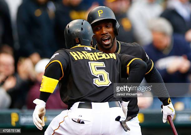 Josh Harrison of the Pittsburgh Pirates is congratulated by teammate Andrew McCutchen after hitting a solo home run in the first inning against the...