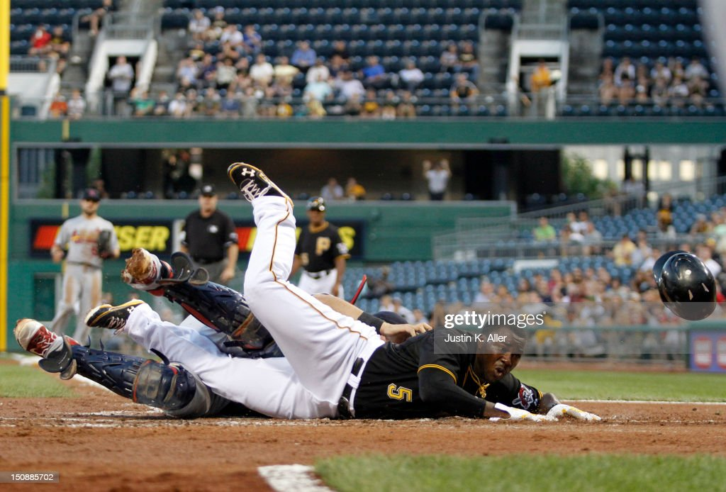 Josh Harrison #5 of the Pittsburgh Pirates is thrown out on a collision at home against <a gi-track='captionPersonalityLinkClicked' href=/galleries/search?phrase=Yadier+Molina&family=editorial&specificpeople=172002 ng-click='$event.stopPropagation()'>Yadier Molina</a> #4 in the second inning during the game on August 28, 2012 at PNC Park in Pittsburgh, Pennsylvania.