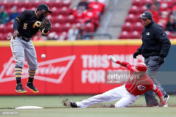 Josh Harrison of the Pittsburgh Pirates is unable to handle the throw as Billy Hamilton of the Cincinnati Reds safely slides into second base after...