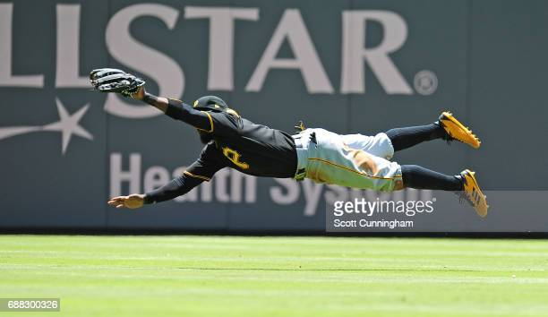 Josh Harrison of the Pittsburgh Pirates makes a diving catch during the third inning against the Atlanta Braves at SunTrust Park on May 25 2017 in...