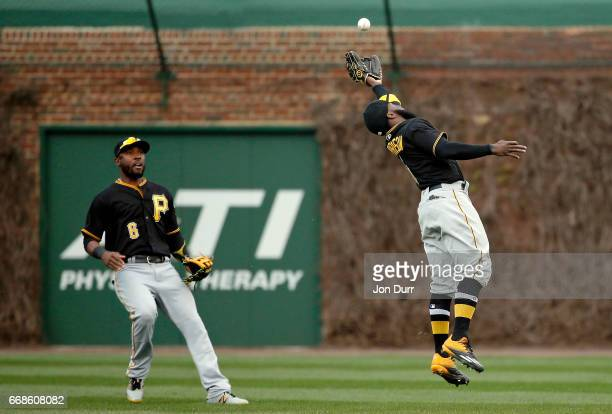 Josh Harrison of the Pittsburgh Pirates makes a leaping catch for an out on a ball hit by Albert Almora Jr #5 of the Chicago Cubs during the ninth...