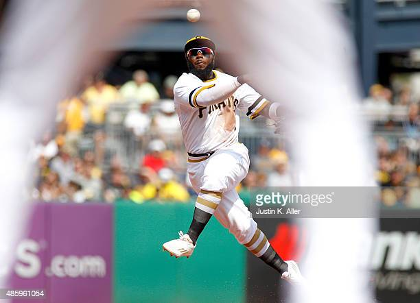 Josh Harrison of the Pittsburgh Pirates makes a throw to first base in the sixth inning during the game against the Colorado Rockies at PNC Park on...